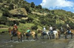 Pony Trekkers riding back across the Mahaleng River towards Malelea