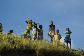A group of Basotho children watching the passerby from the top of a hill in Lesotho