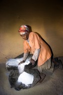 Grinding corn on the traditional stones